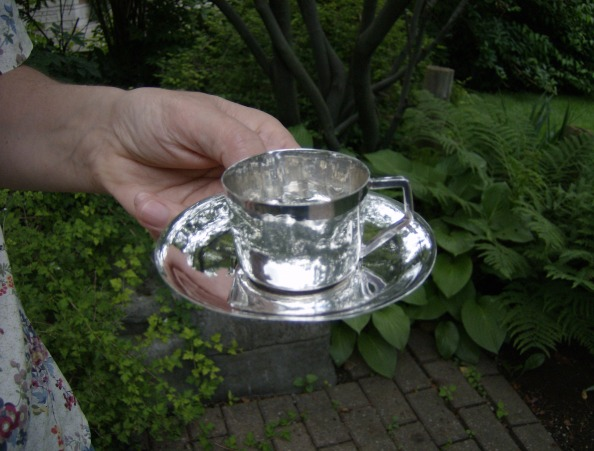 silver demi-tasse and saucer